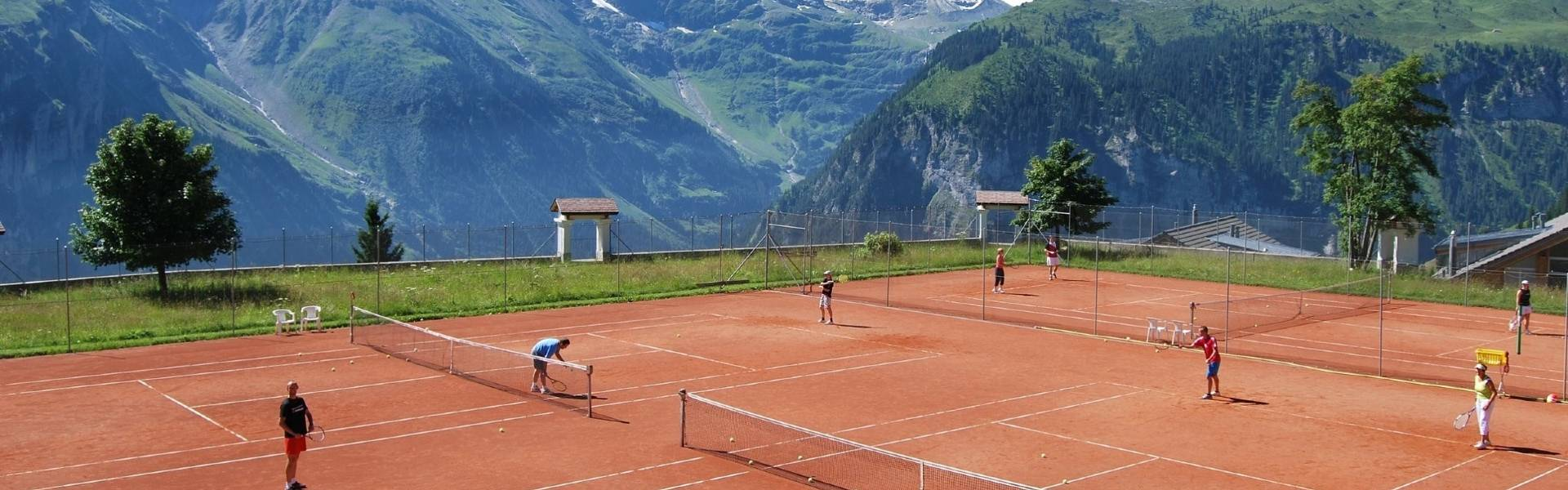Stanglwirt Hotel outdoor clay tennis courts